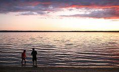 Kids skipping stones at Madge Lake in Duck Mountain Provincial Park, #Saskatchewan.