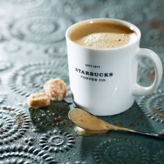 A classic ceramic coffee mug featuring the Starbucks® name and founding year.