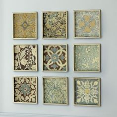 you can accomplish the same look with scrapbook paper and dollar store frames.  i'm going to have to do this project!