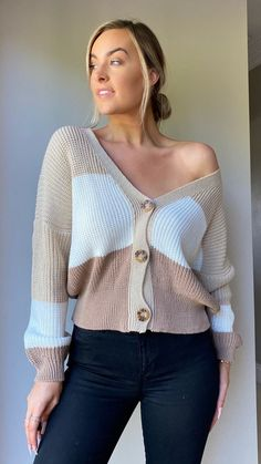 Look effortlessly chic in this beige long sleeve button cardigan.