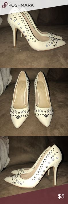 Aldo size 7 white embellished heels Aldo size 7 white embellished heels it's missing a few stones please look at photos for condition aldo Shoes Heels