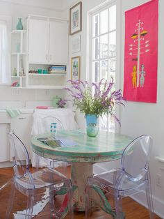 eclectic eat in kitchen idea in atlanta with flat panel cabinets - Flat Panel Dining Room Decorating