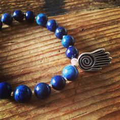 New Lapis Lazuli and Silver Wrist Mala with Hamsa charm!  #buddhism hamsa #lapis #lapislazuli #healing #power #strength #jewelry #bracelet #malabeads #yoga #yogabeads