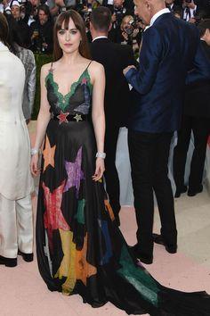 Dakota Johnson in a Gucci dress and Norman Silverman jewellery   - HarpersBAZAAR.co.uk