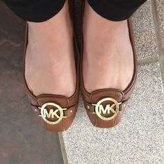 Michael Kors Camel Flats Well loved - but still cute. Heels and toes have scuffing, noted in pictures. Interior stained. More pictures send upon request. Non smoking home. Price already taken into consideration for condition. KORS Michael Kors Shoes Flats & Loafers