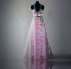 "The Aurora Dress. Full LED Gown. Watch the videos. SO COOL.   ""Made with silk taffeta and chiffon, the Aurora Dress includes LEDs technology that creates many different patterns, from sparkly colors to an incredible fall of rainbow""- Cute Circuit."