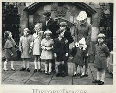 Royal cousins.  Lord George and Lady Helen, 3rd and 4th from left, with their cousins, from left, Lady Sarah, James Ogilvy, Prince Charles, Prince Andrew behind David, Viscount Linley, Princess Anne holding little Marina Ogilvy, and Prince Edward.