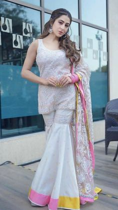 Check out upcoming movie of Sara Ali Khan. Party Wear Indian Dresses, Designer Party Wear Dresses, Indian Gowns Dresses, Indian Fashion Dresses, Dress Indian Style, Indian Wedding Outfits, Indian Designer Outfits, Designer Wear, Bollywood Outfits