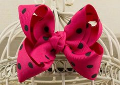 Handcrafted Polka Dot Boutique Bow.  Shocking Pink hair bow with black dots.