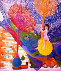 Toshiko Horiuchi-MacAdam constructs large, interactive crochet nets that provide a totally unique play experience at several sites in Japan.