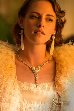 Decked out in furs and pearls, the object of Bobby's affection, Kristen Stewart plays the enigmatic Vonnie.  A perfect example of flawless 1930's Hollywood glam and luxury. Guaranteed to steal his heart! Café Society is in cinemas September 2