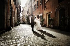 Romantic wedding. Couple walking in ancient roman streets