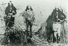 Most Indian scouts in the Arizona Territory served faithfully, such as Slim Jim (at left), although a few mutinied or went astray, such as Eke-be-nadel (center), later known as the Apache Kid. Here, the scouts pose with another scout near their wickiups at Bisbee Canyon in this C.S. Fly photograph from 1885.
