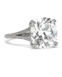 Cushion-Cut Diamond Engagement Ring from Tiffany and Co.    Cushion-cut diamond split-shank ring set in platinum.