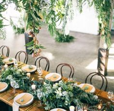 The barn at Stones of the Yarra Valley    tablescape, low spilling flowers • hanging floral installation • wedding reception