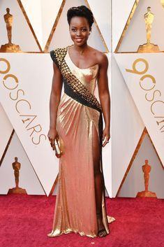 See All the 2018 Oscars Red Carpet Arrivals - Lupita Nyong'o in Atelier Versace from InStyle.com
