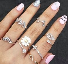 REALLY like the style of the smaller rings that sit toward the top of the finger. Do not like the design of these. Like plain bands