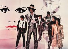 I always found it amusing how Prince was made to look like a GIANT with his band members in this classic poster! You know he's about at Brownmark's left shoulder, with hat!