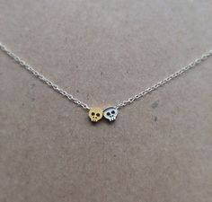 Double tiny skull necklace gold plated rhodium by JewelrybyB