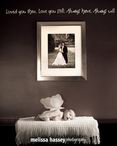 Wedding photo in the background creates a narrative