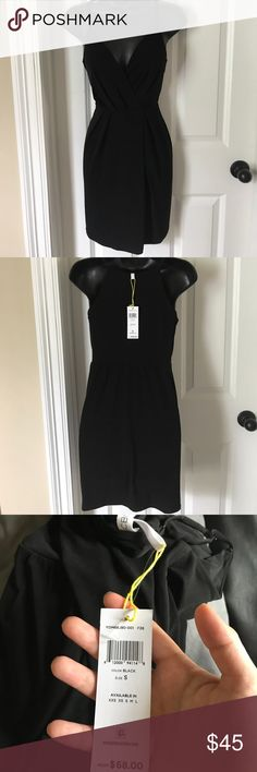 BCBGeneration Black Wraparound Dress Never been worn. Perfect Little Black Dress BCBGeneration Dresses Mini