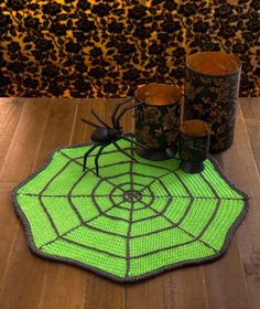 Spider Web Table Mat free crochet pattern in Super Saver yarn. Crochet a creepy spider mat to accent your Halloween decor. Add a purchased spider for skincrawling eeriness and protect your table at the same time. Crochet Fall, Holiday Crochet, Crochet Home, Crochet Crafts, Free Crochet, Knit Crochet, Crotchet, Thanksgiving Crochet, Crochet Kitchen