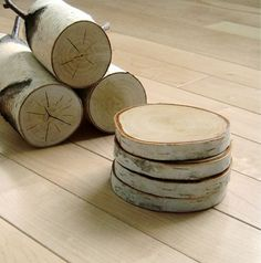 great gift idea... wood coasters. anyone have a saw and some white birch trees i can borrow?