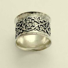 Wide sterling silver wedding band with filigree design