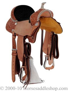 Billy Cook Half Breed. Gorgeous saddle - love the white rawhide trimming and dark seat. Not sure if I like how pale the saddle is, though.