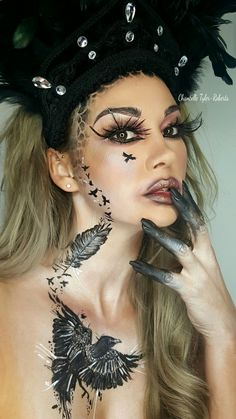 """This was my crow this was captioned """"without darkness one cannot know light"""" id seen a quote that inspired me greatly it was an insight into my depression and how you have to keep on fighting #mua #mac #urbandecay #undiscoveredmua #crow #tattoo #freehand #artisticmakeup #sfx #dupemag #amazingmakeupart #FREEHAND #nofilter #dupemag #artoftheday #photography #mua #bodyart #faceart #facepainting"""