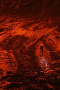 ThanksAn expedition member walks on the cooled lava floor, turned red by the reflected glow of a lake, of a caldera in Nyiragongo volcano in the Democratic Republic of the Congo. Photographed by Carsten Peter for National Geographic awesome pin Mount Nyiragongo, Volcano Wallpaper, Lava Floor, Man Vs Nature, Active Volcano, National Geographic Photos, New Age, Natural World, Congo