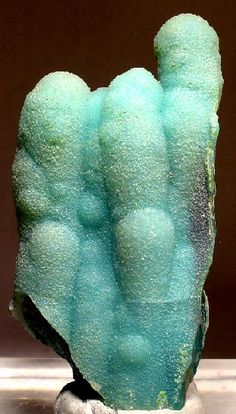 A showy cluster of blue quartz coating chrysocolla stalactites from the famous Ray Mine of Arizona. One side of the cluster is contacted, but does not diminish the beauty of this piece. 6.5 x 3.4 x 1.9 cm