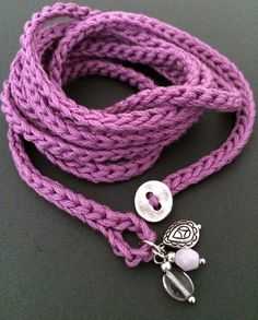 Light and soft crochet wrap bracelet or necklace made of cotton yarn in orchid. This fun and versatile accessory is approximately 54 (137.16 cm) long and wraps about 7 times around a 6 - 7 wrist but can be wrapped more or less times to fit any size. This versatile wrap also makes a great simple, soft necklace that can be worn wrapped, knotted, layered and many other ways around your neck - let your imagination guide you! Closes with a loop and button. Hand wash in cool water, mild soap…