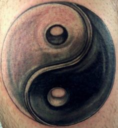 The standard yin and yang symbol tattoo