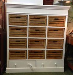 Multi drawer Chest £395. Two white draws under 12 wooden box draws.
