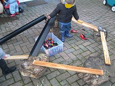 Making roads and ramps from wooden planks and tree stumps from www.pre-schoolplay.blogspot.com