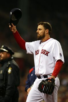 John Lackey #41 of the Boston Red Sox tips his cap after being pulled in the seventh inning against the St. Louis Cardinals during Game Six ...