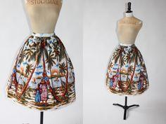Vintage 1950s 50s novelty scenic Caribbean scene print skirt UK 12 14 US 8 10 M(Etsy のAdvantageInVintageより) https://www.etsy.com/jp/listing/399475165/vintage-1950s-50s-novelty-scenic