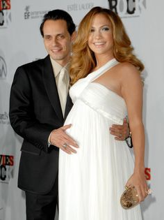 Pin for Later: You Have to See These 89 Celebrities' Ultimate Maternity Looks Jennifer Lopez Jennifer Lopez stunned in a white Versace Resort gown while attending the 2007 Movies Rock event with her then-husband, Marc Anthony. Celebrity Maternity Style, Stylish Maternity, Maternity Fashion, Celebrity Photos, Celebrity Style, Maternity Styles, Pregnancy Looks, Pregnancy Outfits, Jennifer Lopez Pregnant