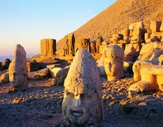 A sunrise on the top of the mountain of Nemrut, in Adıyaman, Turkey. The giant statues of ancient gods made in the honor of the Commagene King Antiochus I are a world heritage.