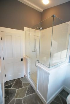 wainscoting and frameless glass shower enclosure. not fond of the tile finish at the top but the framing is nice. Glass Shower Doors, Glass Bathroom, Bathroom Renos, Bathroom Ideas, Master Bathroom, Bathrooms, Glass Showers, Bathroom Showers, Glass Doors