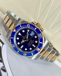 Rolex Submariner Steel & Gold Blue our bestselling watches, this Rolex Submariner is a bi-metal, two tone Steel & Gold model, with a striking ceramic blue bezel & dial. Comes complete with all original box & papers and Rolex International warranty. Rolex Submariner Black Gold, Rolex Submariner 5513, Submariner Watch, Rolex Watches For Men, Best Watches For Men, Luxury Watches For Men, Rolex Batman, Vintage Rolex, Vintage Watches