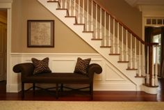 Foyer bench & I like the painted stair risers and spindles