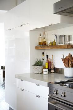 reclaimed wood shelf + white lacquer cabinets