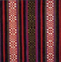 Zemgale or Semigallian Costume, Latvia. Here is a closeup of the 'cats paw' design of the first skirt.