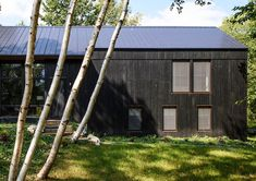 A black exterior, Scandi-style. See more atArchitect Visit: A Natural Swimming Pool and Passive House in the Hudson Valley.