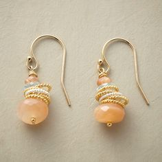 """CIRQUE EARRINGS -- A pair of sterling, 14kt and gemstone earrings, wherein roped rings of sterling silver and 14kt gold filled tumble among peach moonstones and aquamarines. 14kt gold filled French wires. Exclusive. Handmade in USA. 1""""L."""