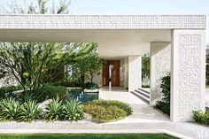 Interior designer Michael S. Smith renovated this early 1970s Howard Lapham house in Rancho Mirage, California, as a weekend retreat to share with his partner, diplomat James Costos, The Mayan-inspired embellishments are original to the home.