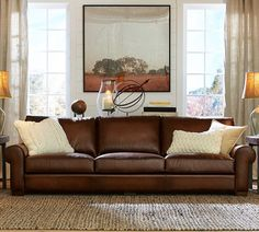 "Pottery Barn Turner Leather Roll Arm Sofa - light or dark brown leather, 78"" 90"" 109"", $2800 2014. Matching Armchair and Ottoman."