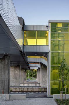 Colourful stairwells zigzag up to meet a new pedestrian bridge in Sweden.